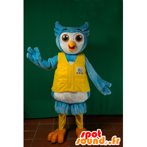 Blue and white owl mascot with a yellow vest - MASFR032211 - Mascot of birds