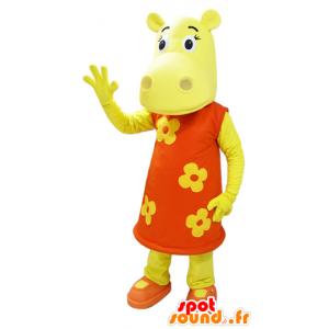 Gekleed met gele hippo de mascotte van een oranje gebloemde jurk