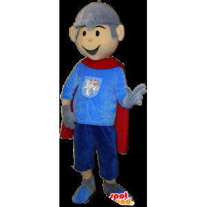 La mascota del caballero con una capa y un casco