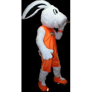Blanco mascota del conejito vestido con una ropa deportiva de color naranja - MASFR032406 - Mascota de deportes