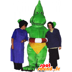 Dragon mascot, green dinosaur with a yellow slip - MASFR032486 - Dragon mascot