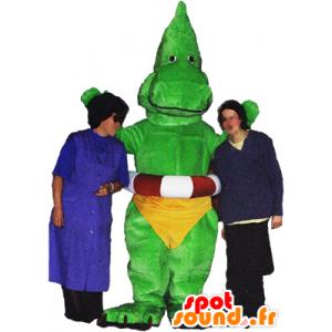 Mascotte de dragon, de dinosaure vert avec un slip jaune - MASFR032486 - Mascotte de dragon