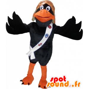 Czarny i pomarańczowy kruk maskotka z hełmem pilota - MASFR032526 - ptaki Mascot