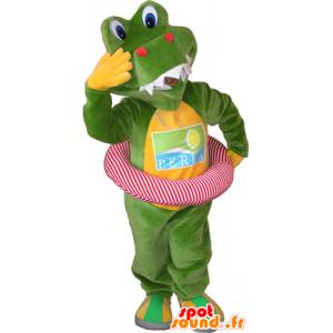 Mascotte de crocodile vert et jaune avec une bouée