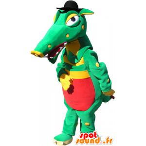 Mascotte de crocodile vert, jaune et rouge avec un chapeau noir