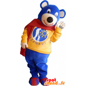 Liten blå nallebjörnmaskot som bär en röd halsduk - Spotsound