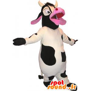 Mascotte de vache blanche, noire et rose