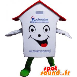 Mascotte de maison blanche, rouge et verte, très souriante
