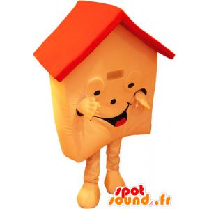 Mascotte de maison orange et rouge, très souriante