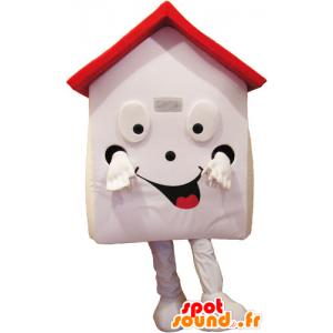 Mascotte de maison blanche et rouge, très souriante