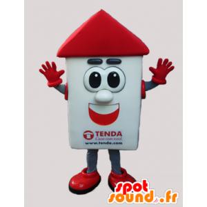 Mascotte de maison blanche et rouge avec de grands yeux