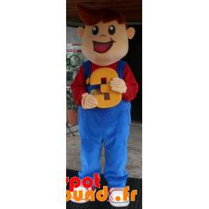 Mascot Smiling Young Boy Dressed In Overalls