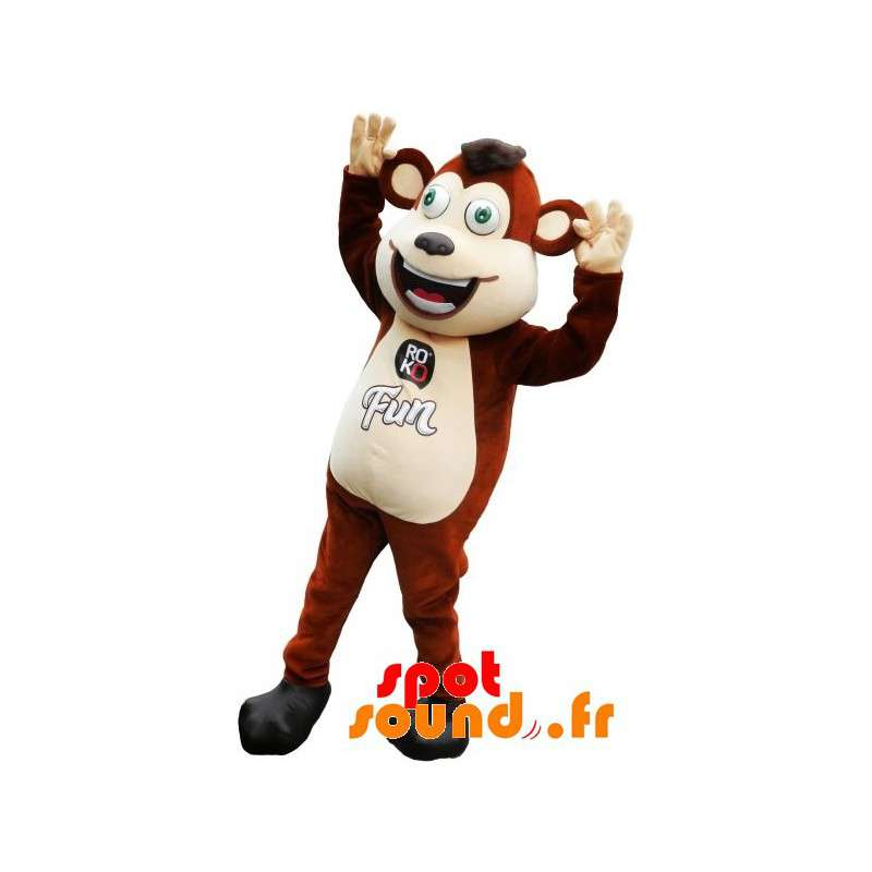 Mascota del mono marrón y blanco con los ojos verdes