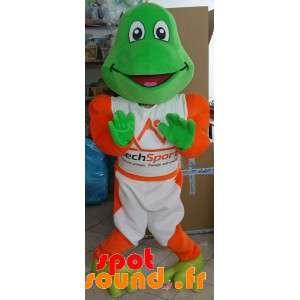 Grön grodamaskot klädd i vitt och orange - Spotsound maskot