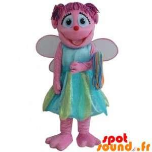 カラフルなドレスで笑顔マスコットピンクの妖精、