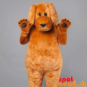 Maskotti iso ruskea koira....