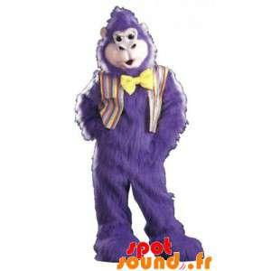 Violetti gorilla maskotti, erittäin karvainen kanssa rusetti