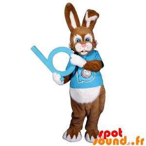 Brun och vit kaninmaskot med en blå outfit - Spotsound maskot