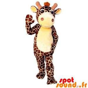 Maskotti ruskea ja keltainen kirahvi, jättiläinen