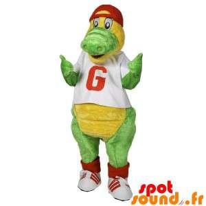 Groen en geel krokodil mascotte gekleed in rood en wit