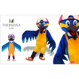 Blå och gul fågelmaskot med en keps - Spotsound maskot