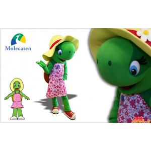 帽子とピンクのドレスと緑のカメのマスコット