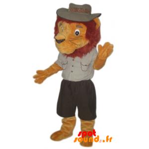Mascotte de lion habillé en tenue d'explorateur