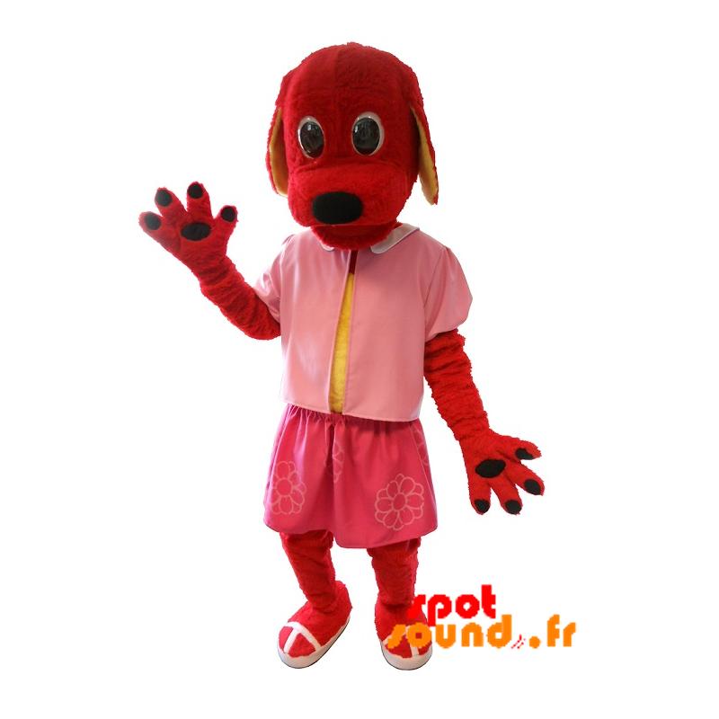 Mascotte de chien rouge habillé en rose. Costume de chien