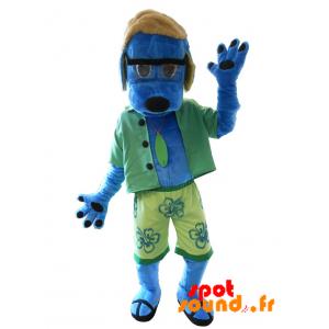 Blå hundmaskot klädd som en semesterfirare. Sommarmaskot -