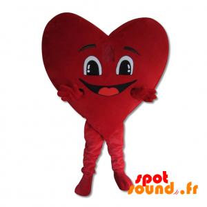 Mascotte de cœur rouge géant, souriant et romantique