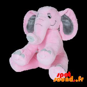 Éléphant rose et gris avec une longue trompe. Peluche éléphant