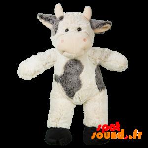 Vache en peluche, grise et blanche. Peluche vache