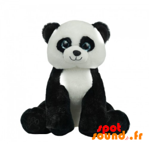 Panda en peluche avec de jolis yeux bleus. Peluche panda