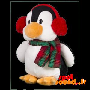 Pingouin en peluche avec un casque pour les oreilles