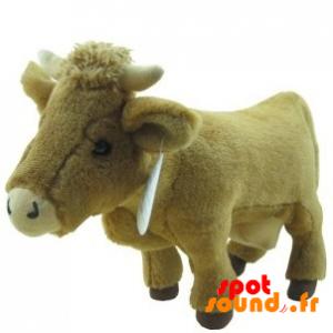 Vache très réaliste en peluche. Peluche vachette - PELFR040359 - plush