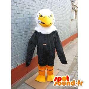 Mascotte aigle classique jaune, noir et blanc avec sourire ravageur