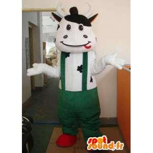 Mascotte vache classique avec pantalon à bretelles vertes