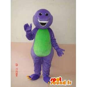 Mascota reptil sonriente púrpura y verde con los dientes