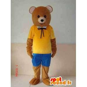 Mascotte ourson marron avec accessoires jaune et bleu. Nature