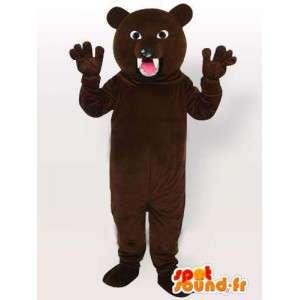 Mascot bruine beer direct vallen met scherpe tanden