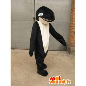Mascote cachalote preto e branco com aletas azuis e olhos