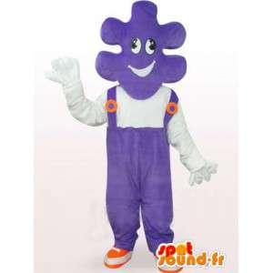 Mascotte de puzzle avec salopette violette et t-shirt blanc