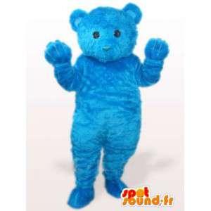 Mascote do urso azul de pelúcia, enquanto algodão macio fibra