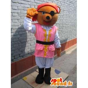 La mascota del oso del pirata: túnica rosada, sombrero rojo y parche en el ojo