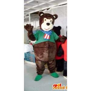 Mascot marrom urso de pelúcia com uma camisa verde
