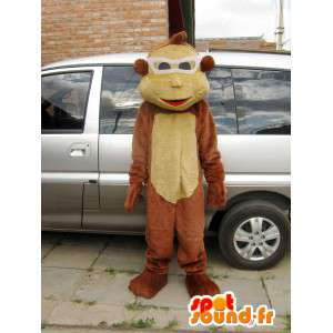 Brun ape maskot plass med brillene