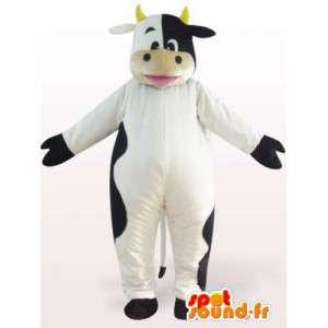 Mascotte de vache noire et blanche avec cornes