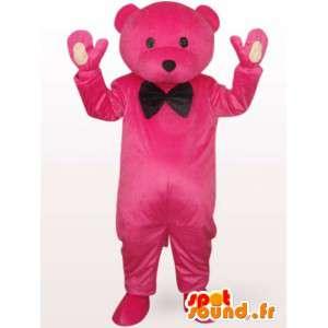 Mascotte ours en smoking rose en peluche avec noeud papillon noir