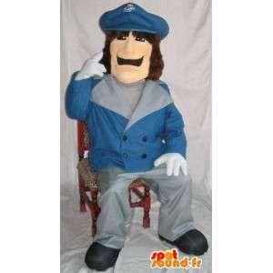 Mascot politimann iført en blå jakke skjold