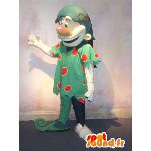 Trollmaskot förklädd till en grön älva med röda vikter -